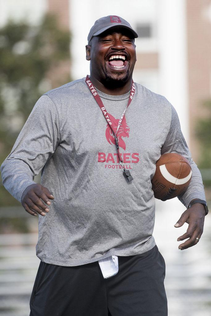 Head Football Coach Malik Hall's high energy  demeanor captured during a practice this season. PHYLLIS GRABER JENSEN/BATES COLLEGE