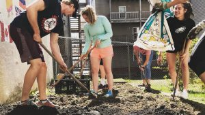 Bates's Swim and Dive team help the center build a garden.  ERIN REED/COURTESY PHOTO