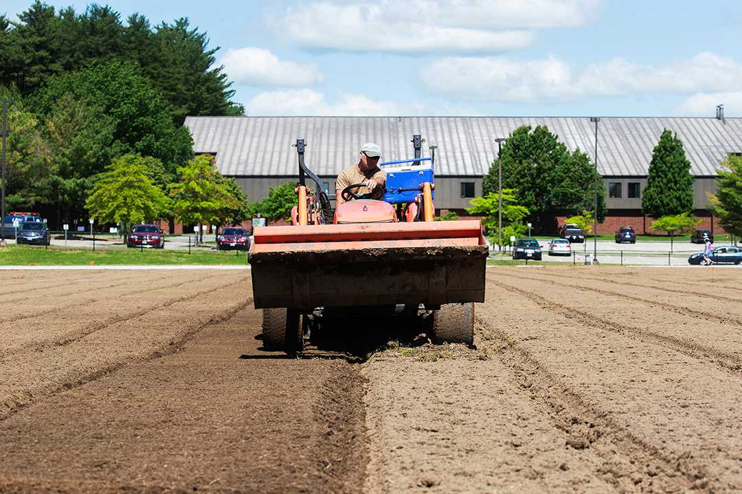 A laser-guided land leveler prepares the Russell Street soccer field for its new sod in mid-June. (Theophil Syslo/Bates College)