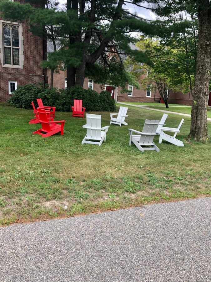 Socially distant adirondack chairs in front of Grey Cage