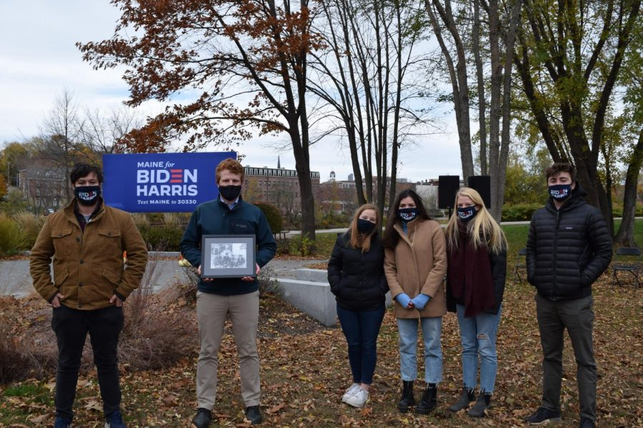 Members of Bates for Biden with Congressman Joe Kennedy III holding a photo of his grandfather, Robert F Kennedy, who attended Bates College from 1944-1945.