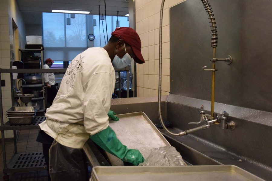 Mohamad Abdi helped wash trays.