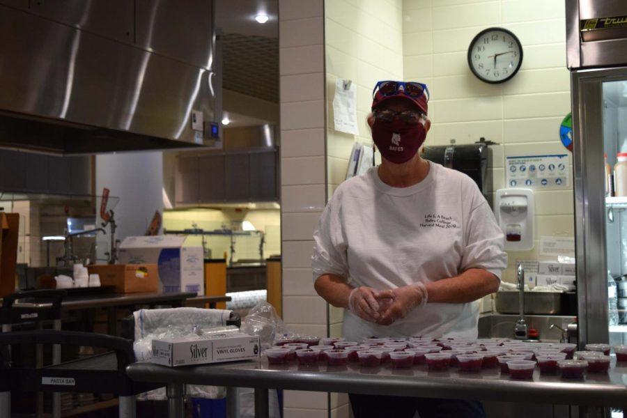 Leola Ballweber helped fill containers with cranberry sauce for students to take to-go.
