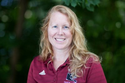 Coach Jennifer Hartshorn has coached her athletes to over 70 NCAA All-American performances and was designated NESCAC Women's Cross Country Coach of the Year in 2016 and 2019.