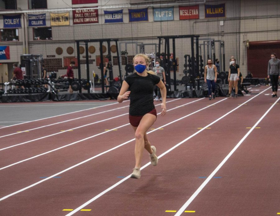 Similar to other teams, Hartshorn is holding practice with small groups of athletes. Here, Alice Cockerham '23 strides during warm-up in preparation at the team's first indoor track practice this year.