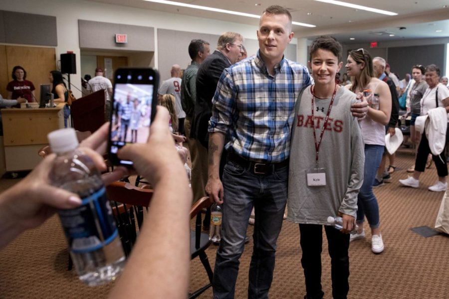 Jared Golden '11 and fellow U.S. Representative Ben Cline '94 spoke at Reunion in 2019. Here, Golden is taking a photo with the son of a Bates alum in Pettengill Hall.