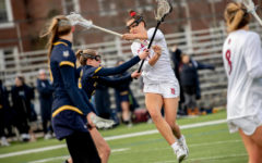 Summer Dias '21 scored two of Bates' five points and posted an assist in the game against Colby.