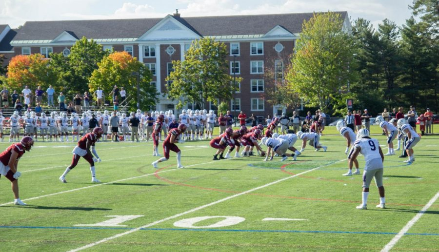 The Bates football team lines up against Amherst. The team could not defeat the Mammoths, continuing the 21-year loss streak.