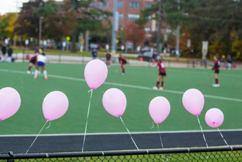 At Saturday's field hockey game, the team added pink balloons and tabled to raise funds for Foundation4Love, a breast cancer wellness nonprofit.